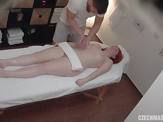 Redhead Czech babe received a massage & pussy fuck