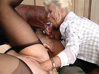 Hot and frying blonde mature fucked and fisted on bed
